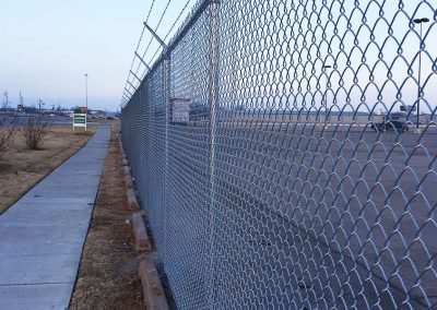 Tall Chain Link Fence - Barbed Wire